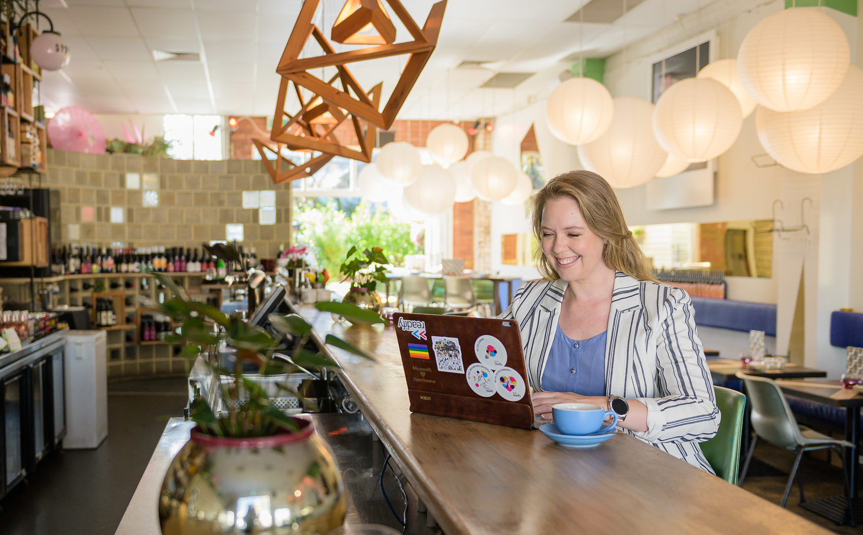 Picture of Donna working at a coffee bar